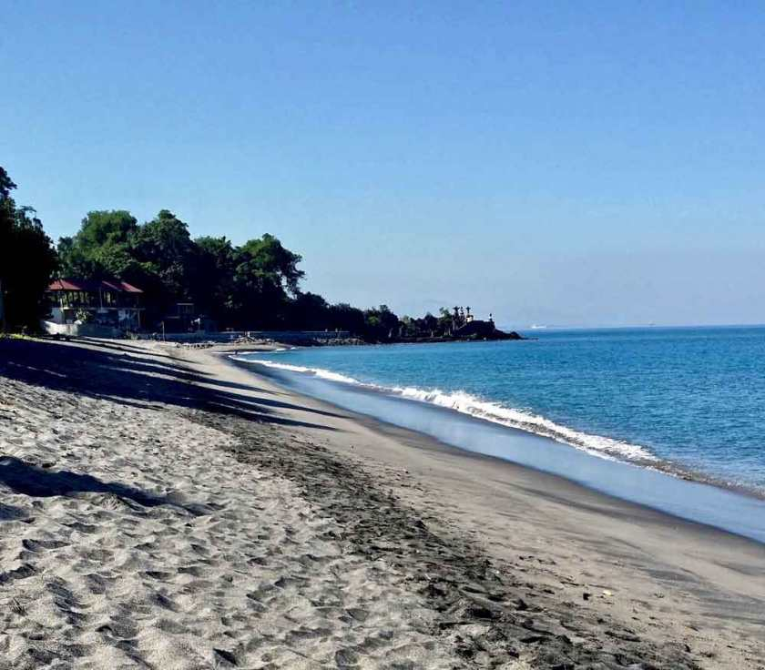 Black sand beach in front of the resort